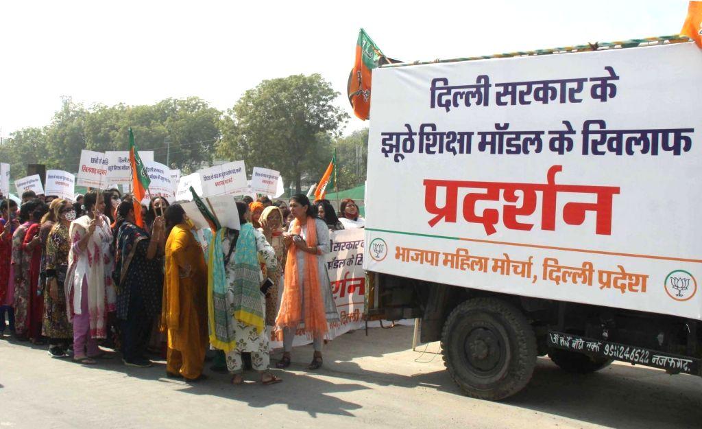 BJP Mahila Morcha demonstration against Delhi Government's education policy Dy CM's residence: AB 17, Mathura Road, New Delhi on Thursday 25th February 2021.