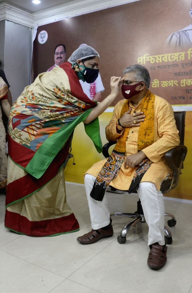 BJP Mahila Morcha President Agnimitra Paul accompanied by the party's women activists celebrate Raksha Bandhan with West Bengal BJP President Dilip Ghosh at the state party headquarter in ... - Dilip Ghosh