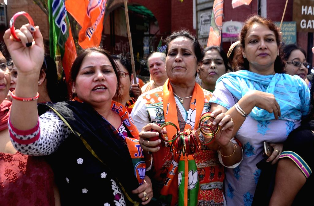 BJP Mahila Morcha workers stage a demonstration against Delhi Chief Minister and AAP leader Arvind Kejriwal, who is on a four-day tour to Punjab ahead of assembly polls, in Amritsar on Sept ... - Arvind Kejriwal