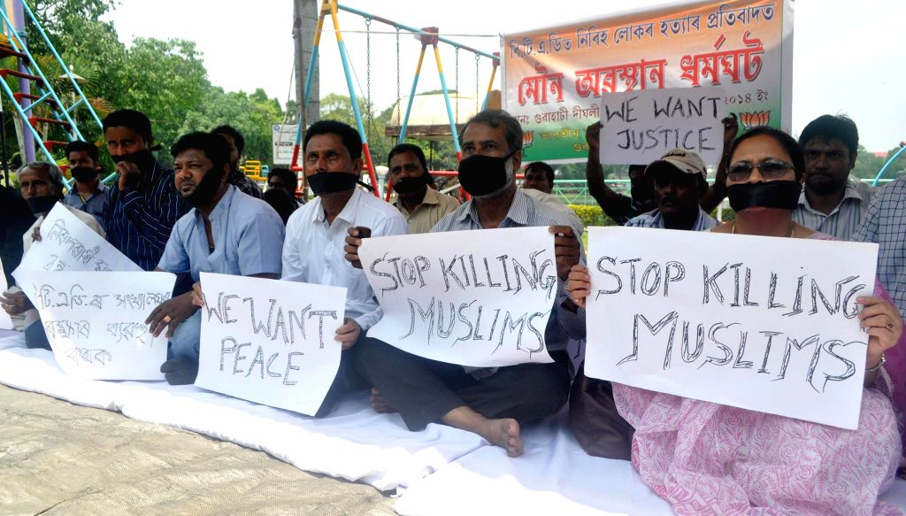 BJP Minority Morcha activists demonstrate against recent violence in Bodoland Territorial Area Districts (BTAD) of Assam, in Guwahati on May 6, 2014.