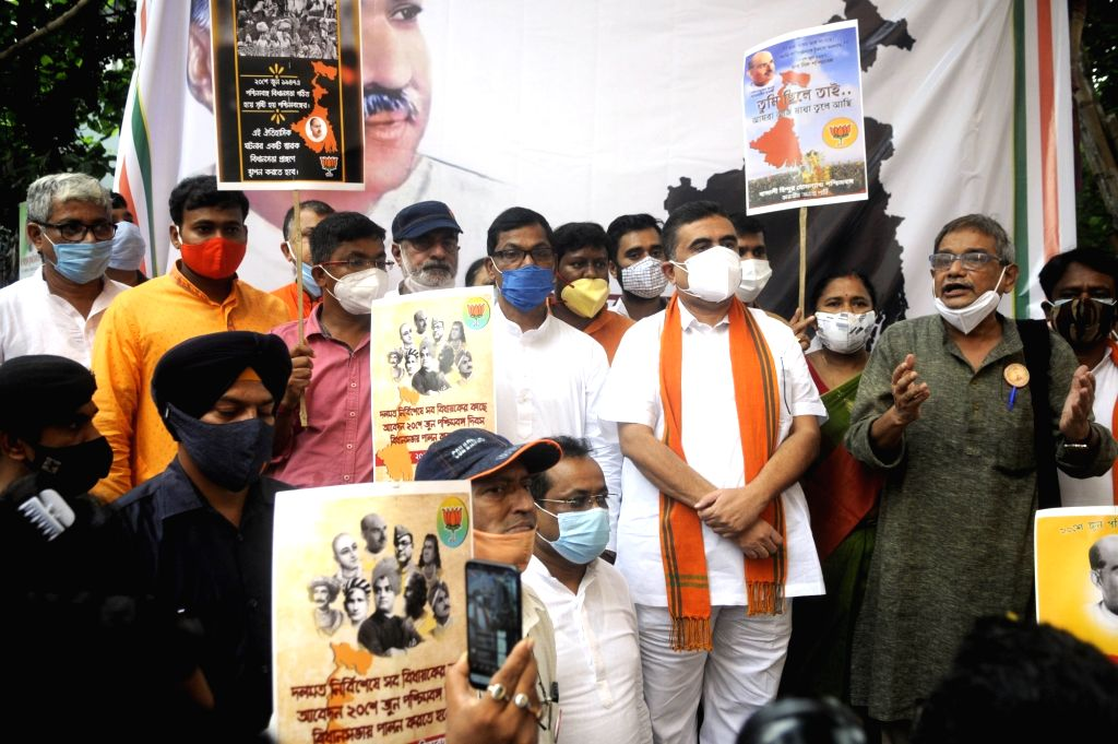 BJP, MLA and Opposition leader of West Bengal Assembly Suvendu Adhikari along with BJP activists celebrate Paschimbanga Dibas at BJP headquarter in Kolkata on Sunday, June 20, 2021.