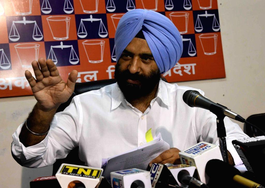 BJP MLA Manjinder Singh Sirsa addresses a press conference in New Delhi, on July 5, 2017. - Manjinder Singh Sirsa