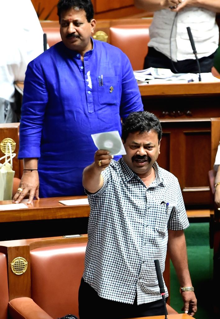BJP MLA MP Renukacharya displays a CD during the Karnataka Assembly budget session at Vidhana Soudha, in Bengaluru on Feb 11, 2019.
