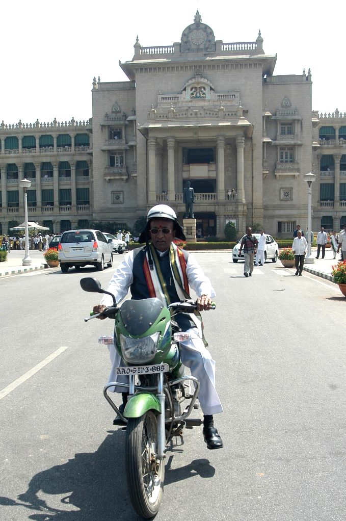 BJP MLA Shankar Linge Gowda going back from the bike after the Karnataka Assembly  Joint Session at Vidhana Soudha, in Bangalore on Monday 4th of February 2013.