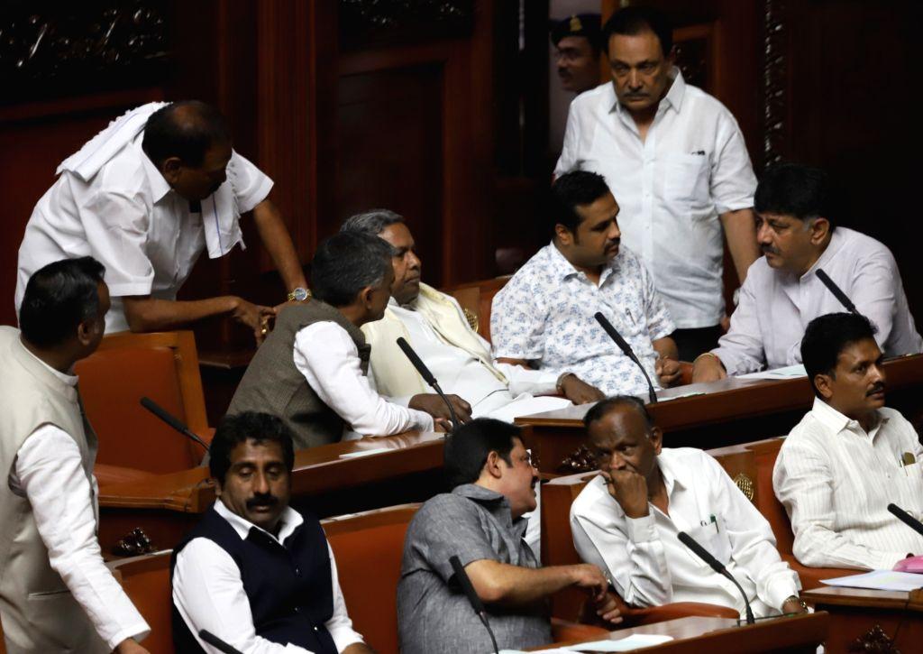 BJP MLA Siddaramaiah, Congress MLA D. K. Shivakumar and other legislators during the Budget Session of Karnataka Assembly, in Bengaluru on Feb 7, 2019.