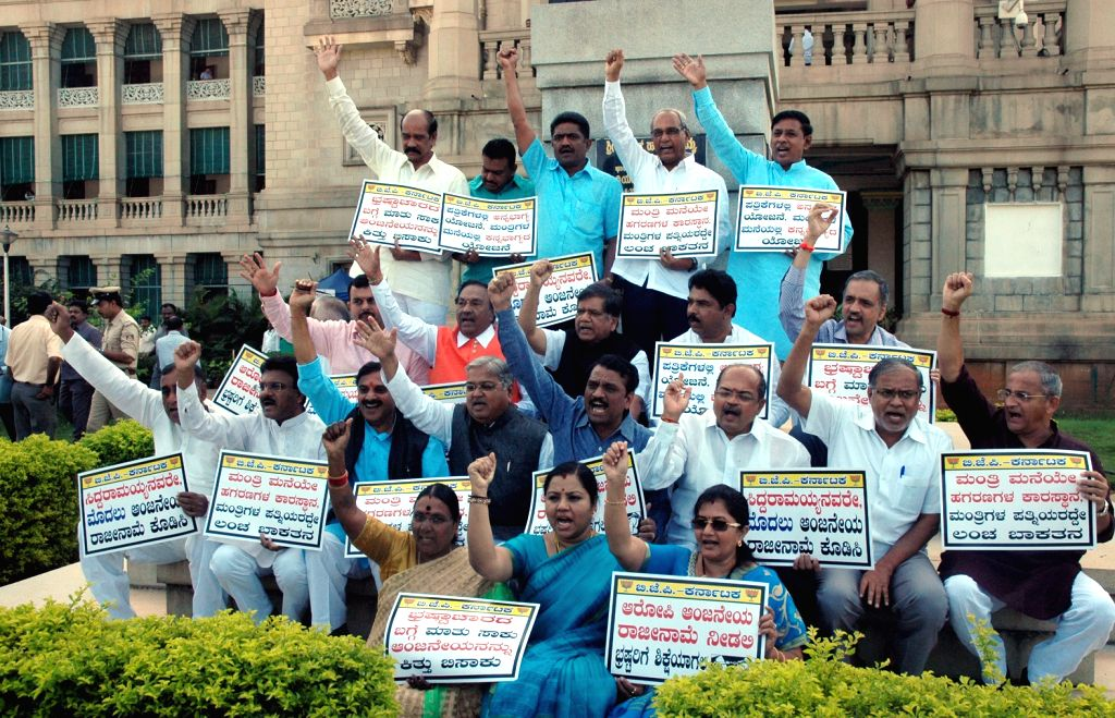 BJP MLAs and MLCs demonstration against the dismissal of tainted Social welfare Minister H Anjaneya in front of Vidhana Soudha in Bengaluru on Nov 27, 2015. - H Anjaneya