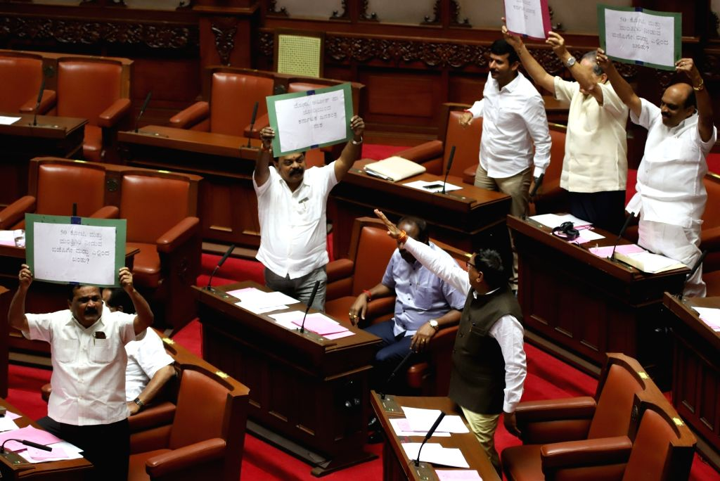 BJP MLAs create ruckus during the Budget Session of the Karnataka Assembly, in Bengaluru on Feb 7, 2019. As soon as the Assembly and Council began the second day of the 10-day Budget ... - K. and R. Ramesh Kumar