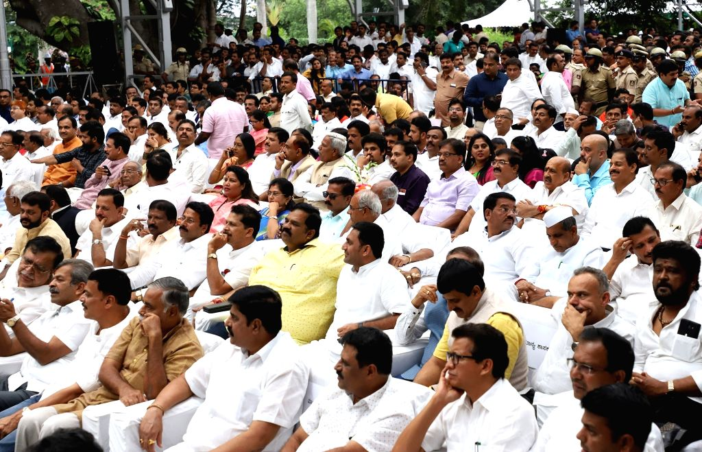 BJP MLAs, MLCs and leaders during B. S. Yediyurappa's swearing-in ceremony at Raj Bhavan in Bengaluru on July 26, 2019.