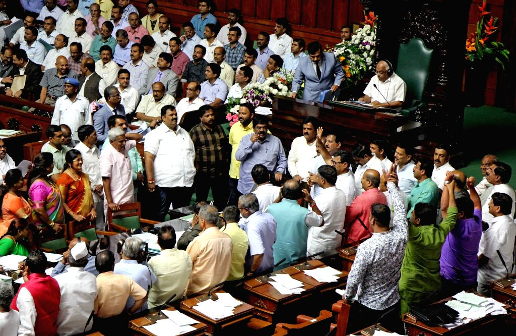 BJP MLAs protest during budget session of Karnataka assembly in Bengaluru, on Feb 14, 2019.