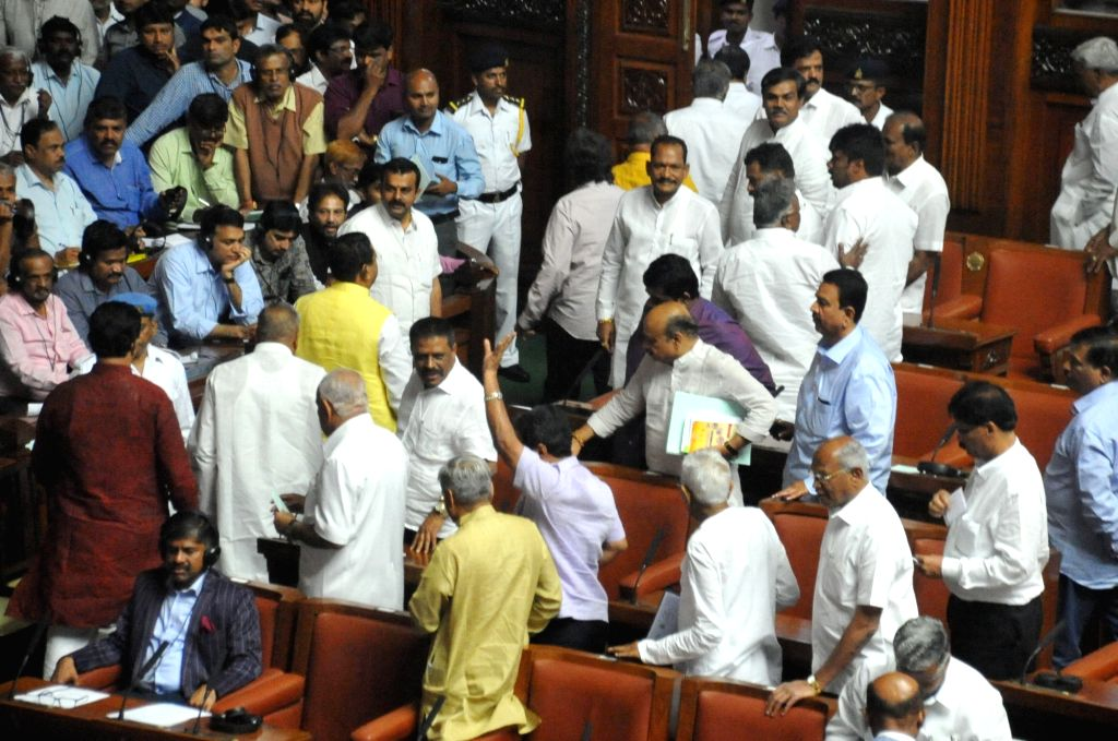 BJP MLAs walk out of Karnataka Assembly during the Budget Session, in Bengaluru on Feb 8, 2019.