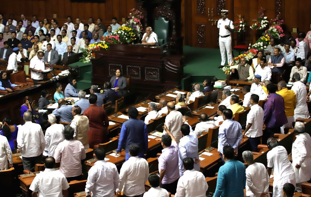 BJP MLAs walk out of the Karnataka Assembly as Karnataka Chief Minister H.D. Kumaraswamy who also holds the finance portfolio, presents the state budget 2019-20, in Bengaluru on Feb 8, ... - H.