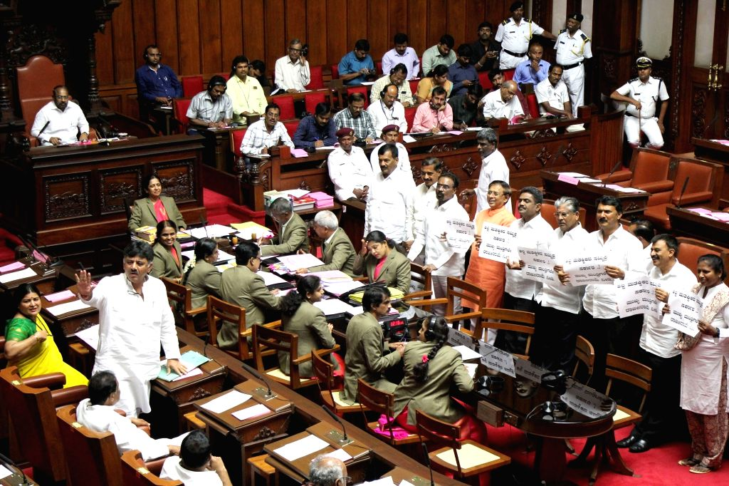 BJP MLCs stage a demonstration during the Karnataka Legislative Council Session at the state assembly, in Bengaluru on July 16, 2019.