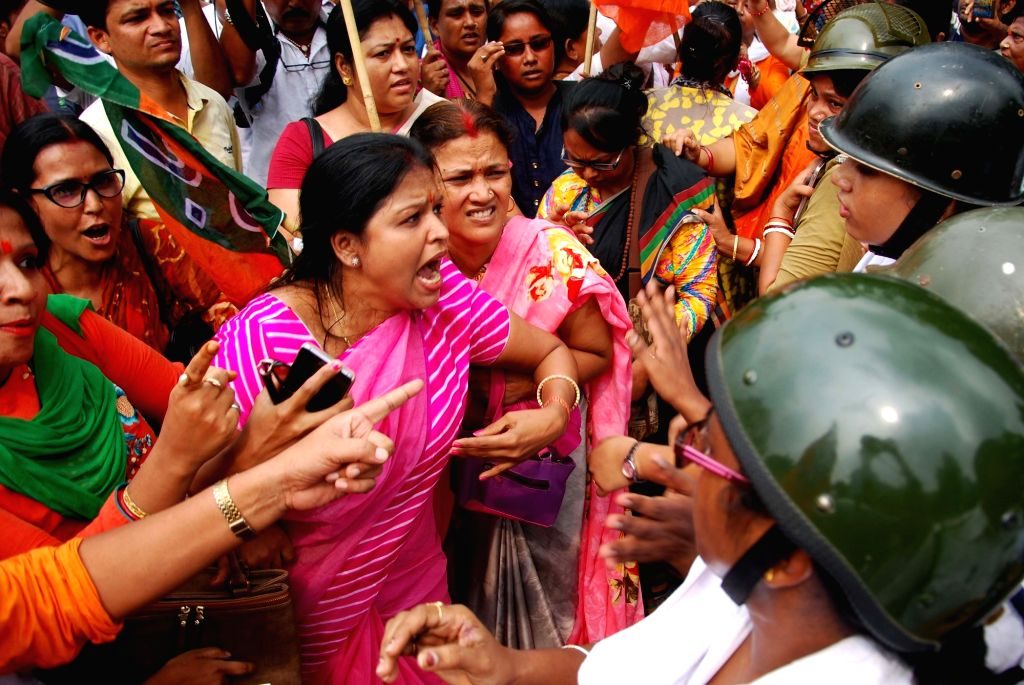 BJP Mohila Morcha activists stage a demonstration against West Bengal Government in Kolkata on Sept 11, 2018.