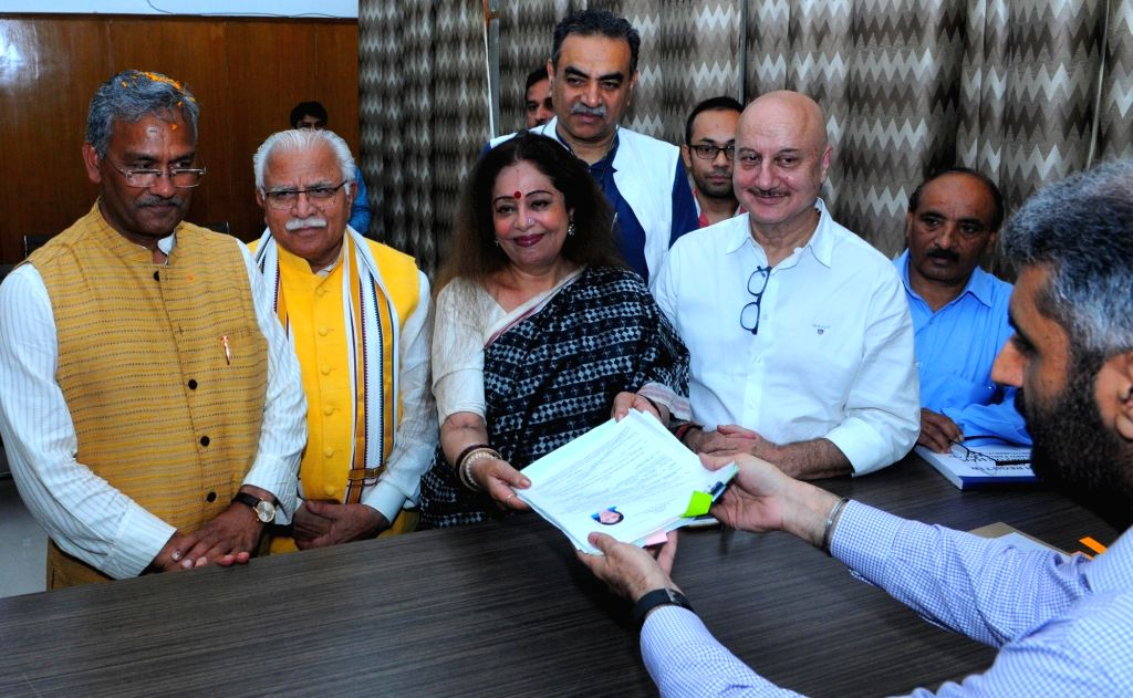 BJP MP and the party's Lok Sabha candidate from Chandigarh, Kirron Kher accompanied by her actor husband Anupam Kher, Uttarakhand Chief Minister Trivendra Singh Rawat and Haryana Chief ... - Trivendra Singh Rawat, Kirron Kher, Anupam Kher and Manohar Lal Khattar