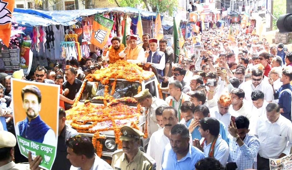 BJP MP and the party's Lok Sabha candidate from Hamirpur, Anurag Thakur with Himachal Pradesh Chief Minister Jai Ram Thakur and Former Chief Minister Prem Kumar Dhumal, during a roadshow ... - Jai Ram Thakur and Prem Kumar Dhumal