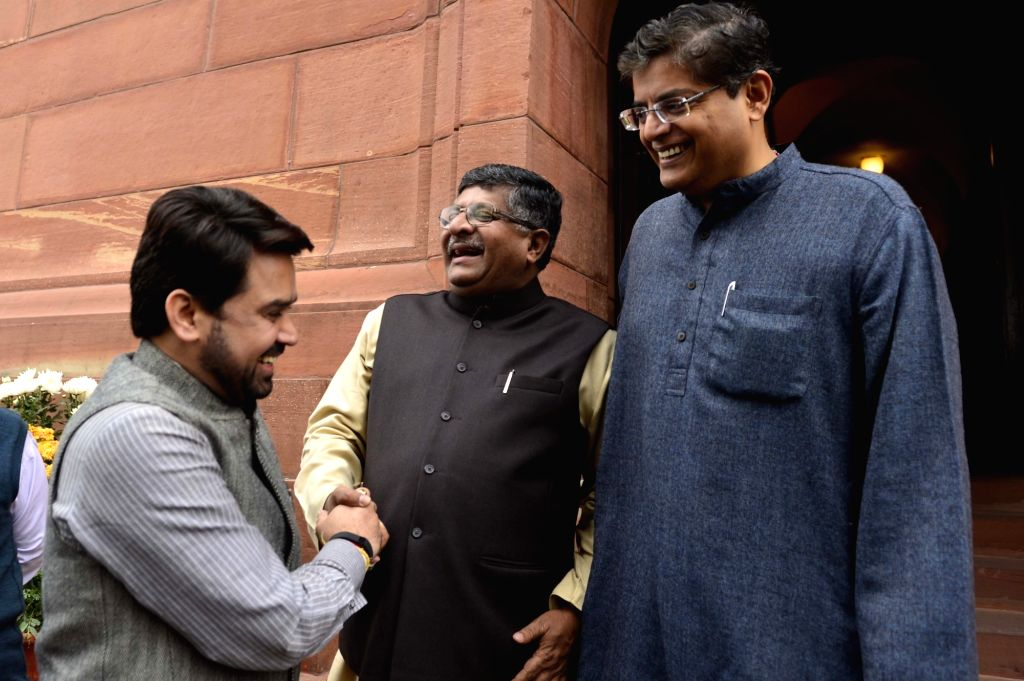 BJP MP Anurag Thakur and Union Telecom Minister Ravi Shankar Prasad at the Parliament in New Delhi, on Dec 9, 2015. - Ravi Shankar Prasad