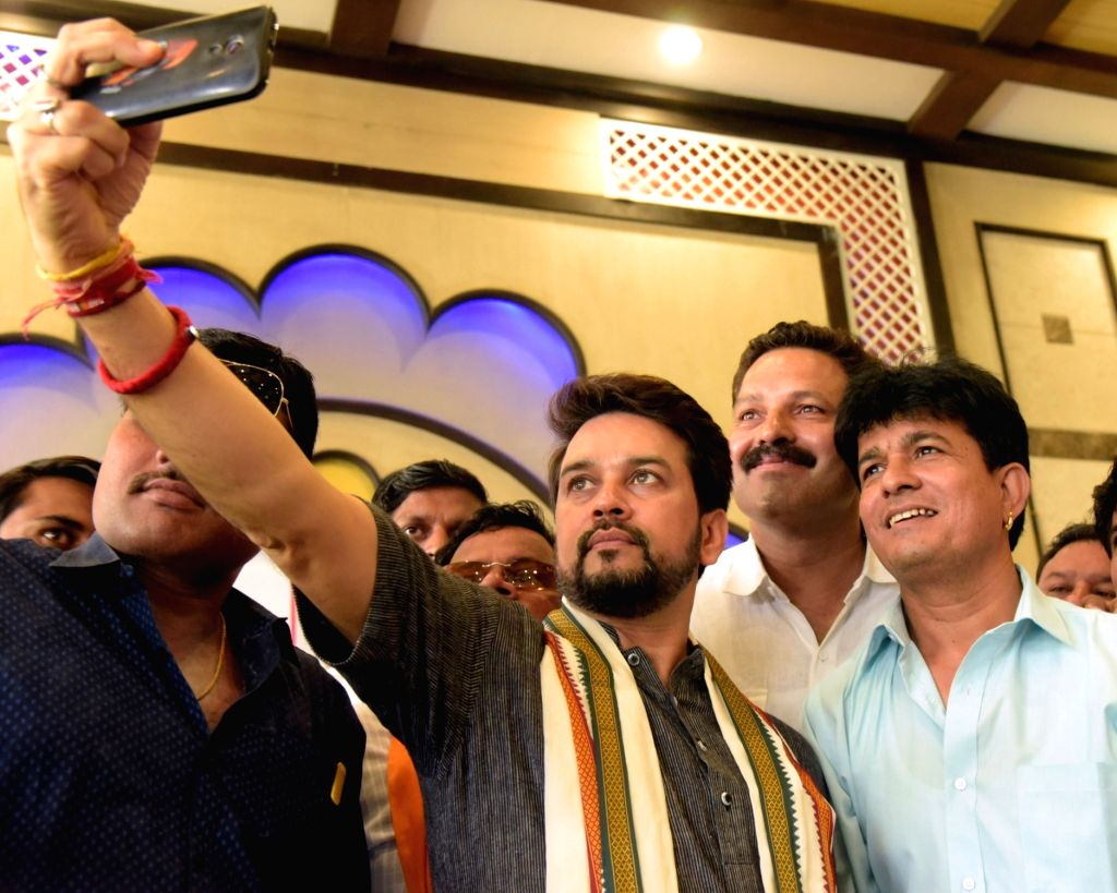 BJP MP Anurag Thakur takes a selfie during a press conference regarding two years of Modi government in Bikaner on June 3, 2016.