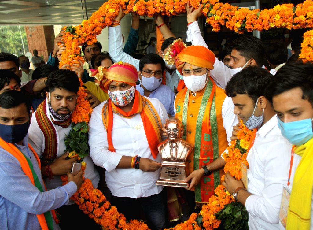 BJP MP from Bengaluru South, Tejasvi Surya being felicitated by party workers on his arrival at the BJP office to take charge as the party Yuva Morcha president, in New Delhi on Oct 19, ...