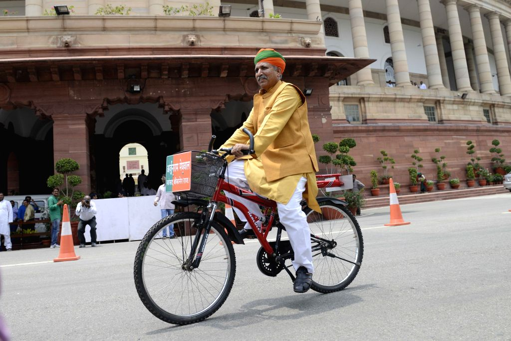 BJP MP from Bikaner, Arjun Ram Meghwal rides a cycle at the Parliament in New Delhi, on July 23, 2015.