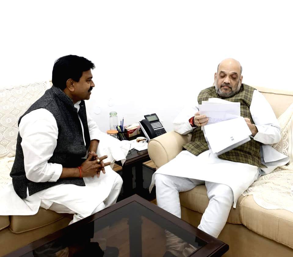 BJP MP from Lakhmipur Kheri Ajay Mishra meets Union Home Minister Amit Shah. - Amit Shah