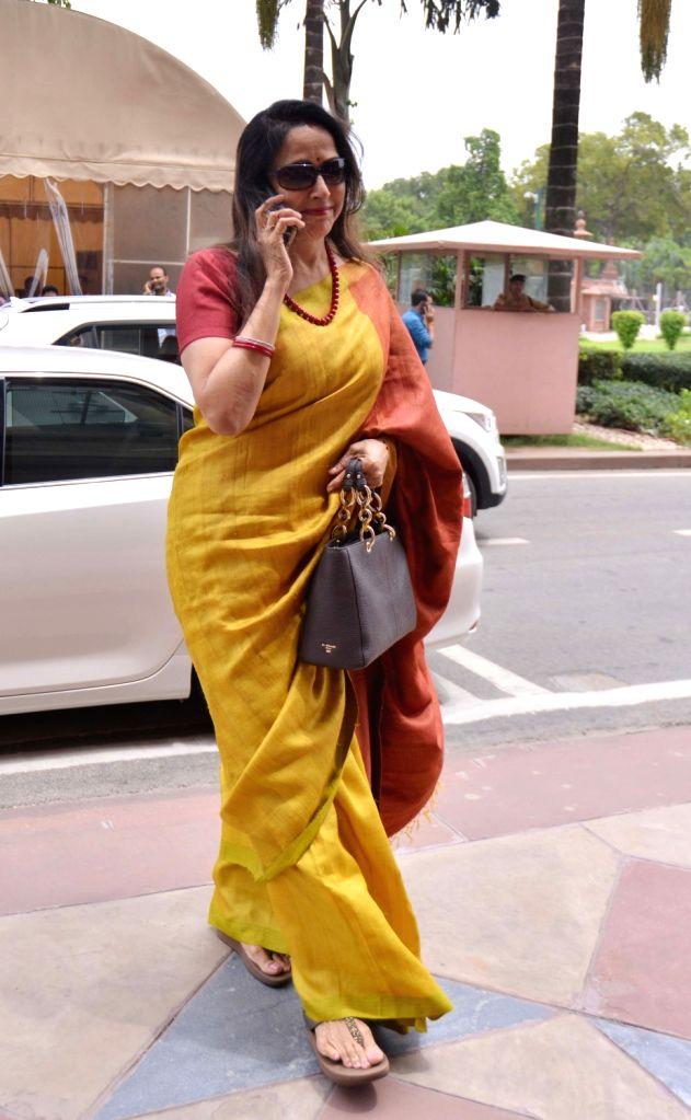 BJP MP Hema Malini arrives at Parliament, in New Delhi on Aug 2, 2018. - Hema Malini