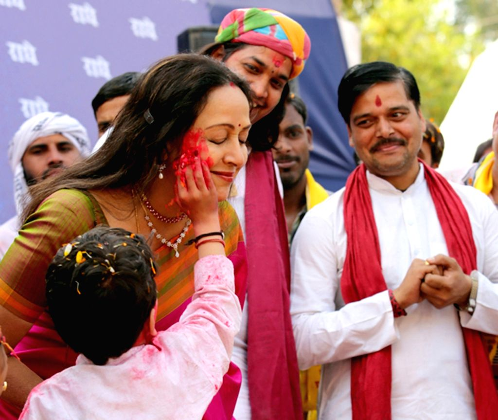 BJP MP Hema Malini celebrates Holi festival in Mathura on March 12, 2017. - Hema Malini