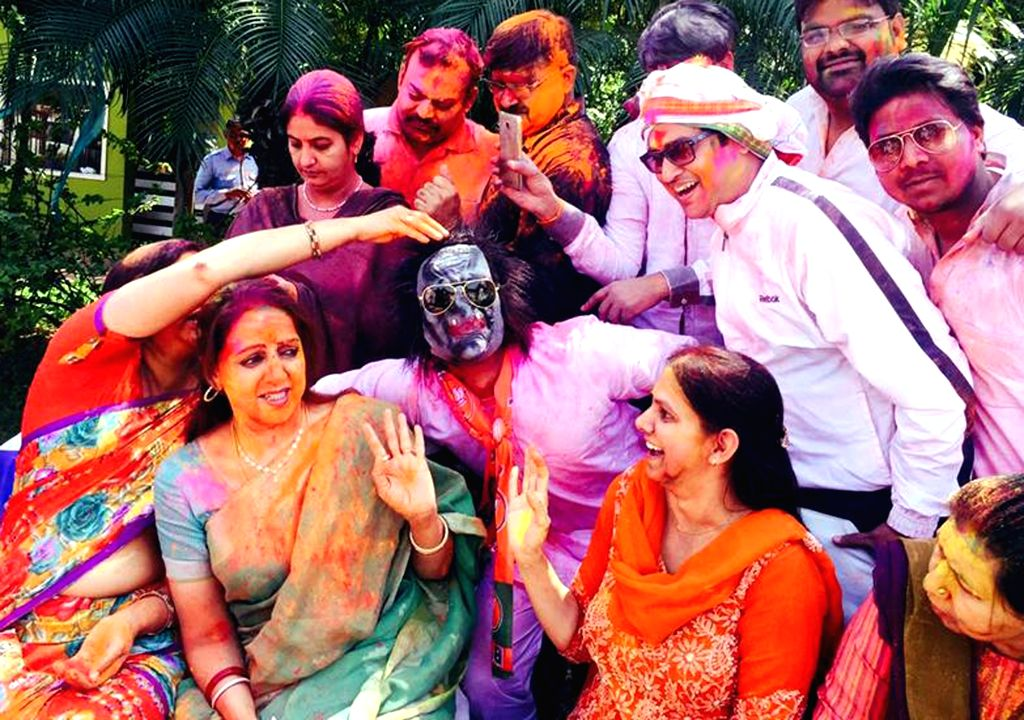 BJP MP Hema Malini celebrates Holi in Mathura on March 13, 2017. - Hema Malini