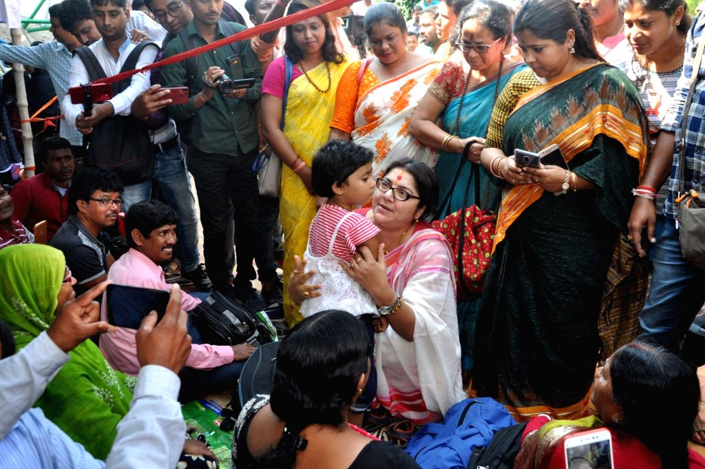 BJP MP Locket Chatterjee shares a warm moment with a child during West Bengal Para Teachers protest organised to press for their various demands, in Kolkata on Nov 15, 2019. - Chatterjee