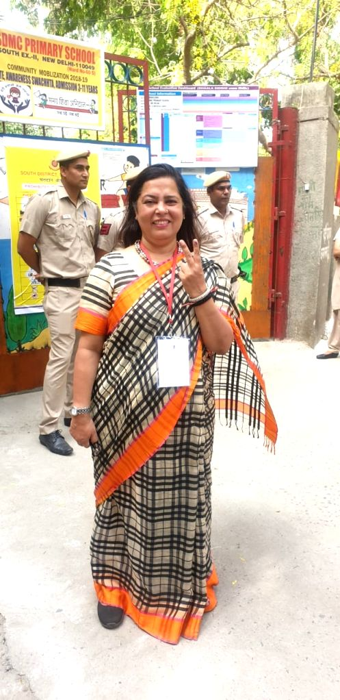 BJP MP Meenakashi Lekhi shows her forefinger marked with indelible ink after casting vote during the sixth phase of 2019 Lok Sabha elections, in New Delhi on May 12, 2019.