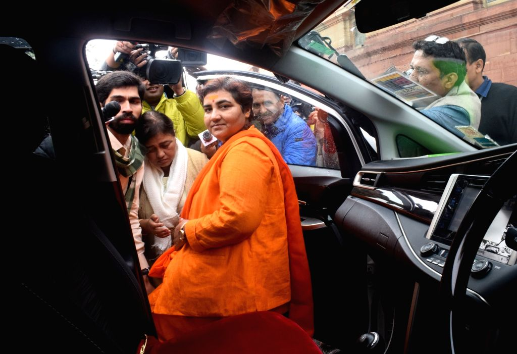 BJP MP Pragya Singh Thakur arrives to pay tributes to the martyrs on 18th anniversary of Parliament attack at Parliament House in New Delhi on Dec 13, 2019. - Pragya Singh Thakur