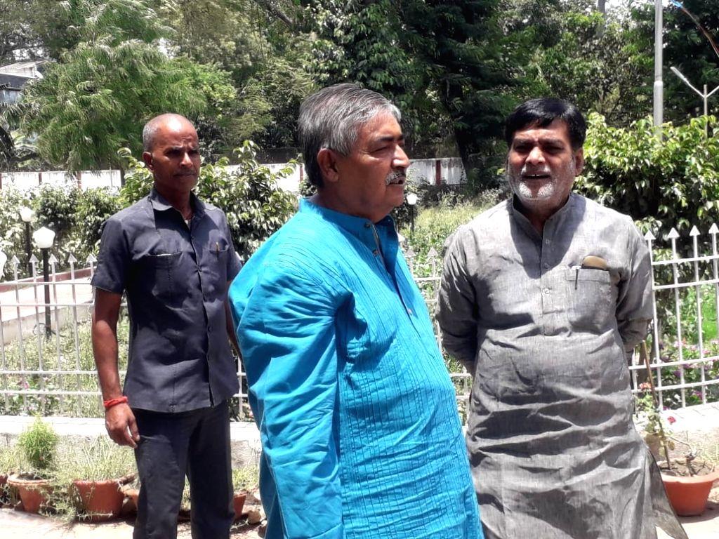 BJP MP Ram Kripal Yadav meets Bihar PHED Minister Vinod Narayan Jha over water crisis in Patna on June 15, 2019. - Vinod Narayan Jha and Kripal Yadav
