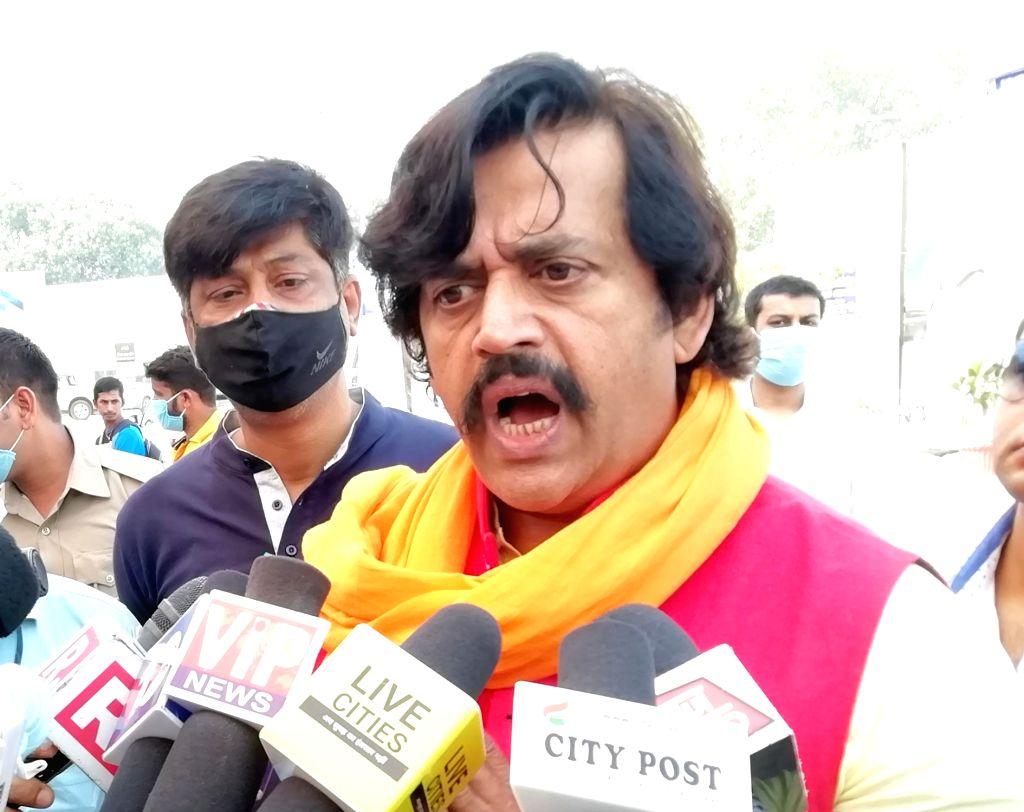 BJP MP Ravi Kishan talks to the media ahead of Bihar Assembly elections, outside the Jay Prakash Narayan International Airport in Patna on Oct 26, 2020.