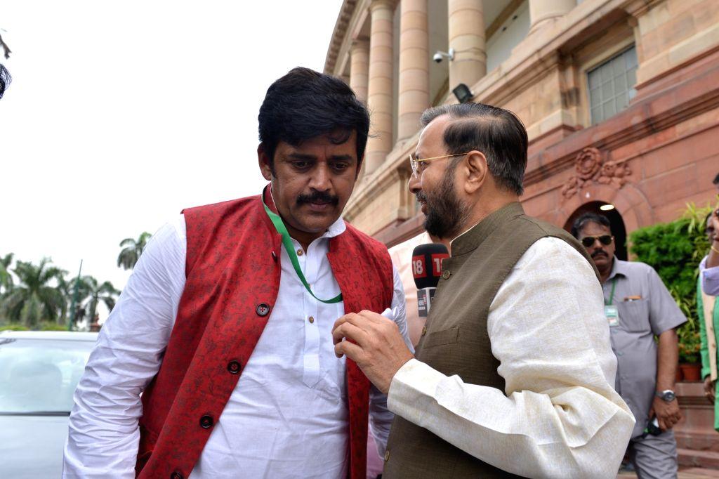 BJP MP Ravi Kishan with Union Environment Minister Prakash Javadekar at Parliament in New Delhi on July 17, 2019. - Prakash Javadekar