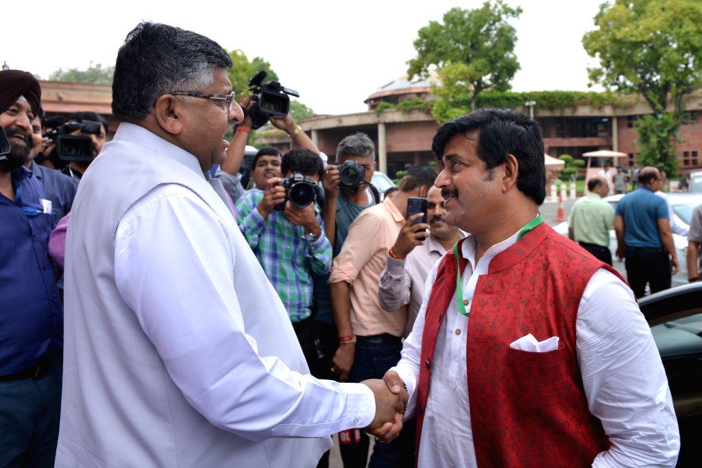 BJP MP Ravi Kishan with Union Law Minister Ravi Shankar Prasad at Parliament in New Delhi on July 17, 2019. - Ravi Shankar Prasad
