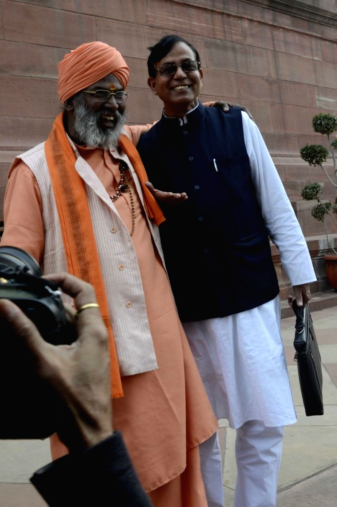 BJP MP Sakhi Maharaj with CPI-M leader Md Salim during the winter session of the Parliament in New Delhi, on Dec 1, 2015.