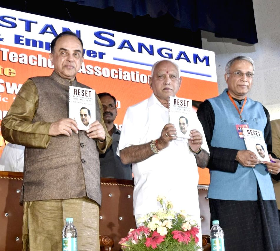 BJP MP Subramanian Swamy being felicitated Karnataka Chief Minister BS Yeddiyurappa during felicitation programme to Subramanian Swamy organised by Virat Hindustan Association, in ... - B