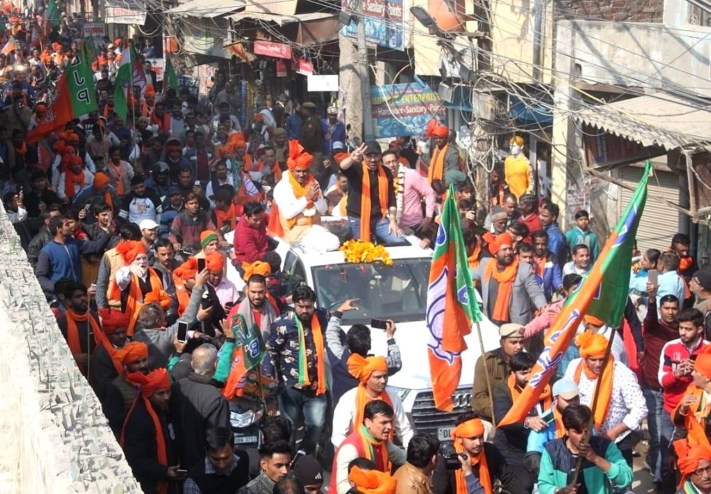 BJP MP Sunny Deol accompanied by the party's Uttam Nagar candidate Krishan Gahlot, holds a roadshow ahead of February 8 Delhi Assembly elections, in New Delhi on Feb 6, 2020.