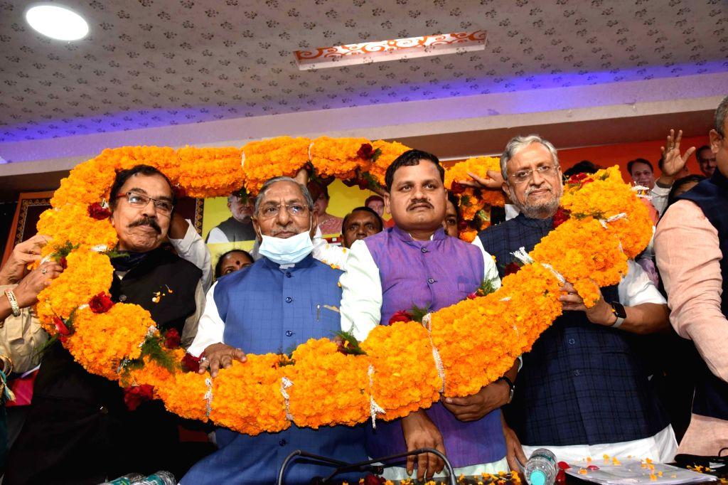 BJP MP Sushil Kumar Modi being garlanded by party leaders during the birth anniversary celebration of Guru Ravidas, in Patna, Friday, February. 26, 2021 - Sushil Kumar Modi