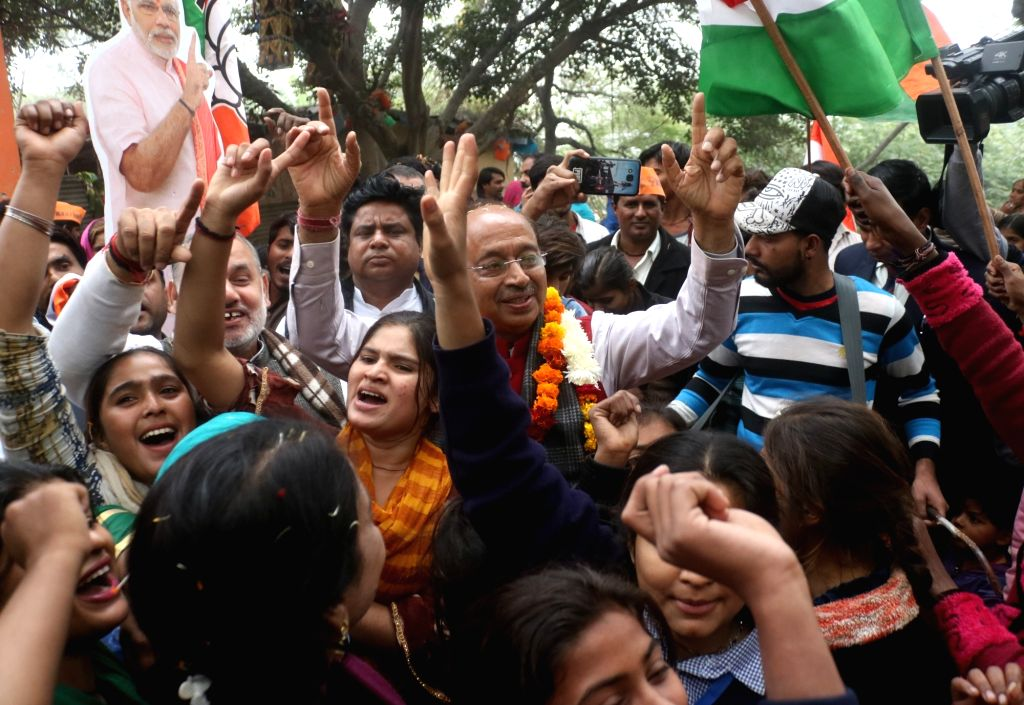BJP MP Vijay Goel celebrates with Hindu refugees from Pakistan living in India, after the Citizenship Amendment Bill 2019 (CAB) was passed in Parliament, in New Delhi on Dec 12, 2019.
