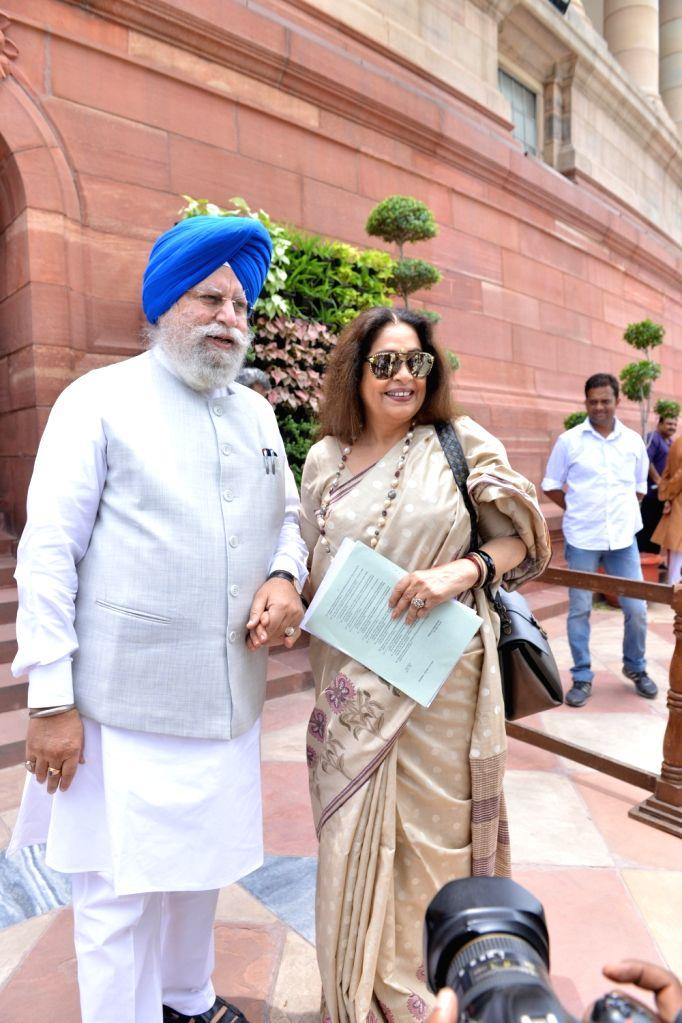 BJP MPs S. S. Ahluwalia and Kirron Kher at Parliament, in New Delhi on July 30, 2018. - Kirron Kher