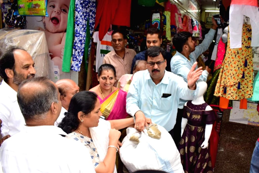 BJP MPs Shobha Karandlaje and P.C. Mohan buy relief material to be distributed among flood victims, in Bengaluru on Aug 10, 2019.