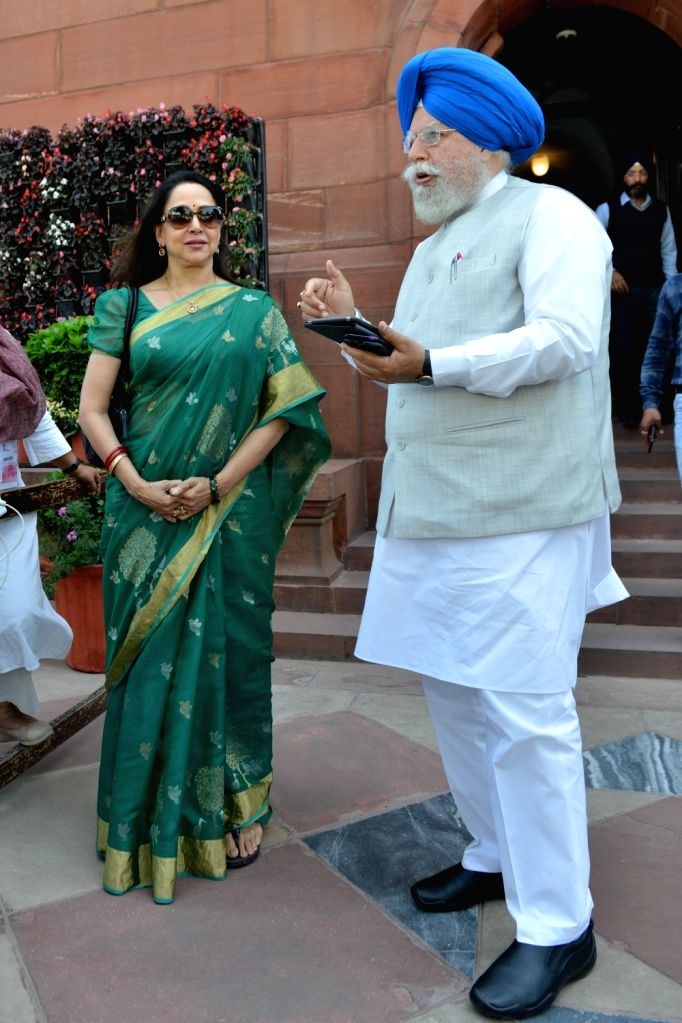 BJP MPs SS Ahluwalia and Hema Malini at Parliament in New Delhi on March 18, 2020. - Hema Malini