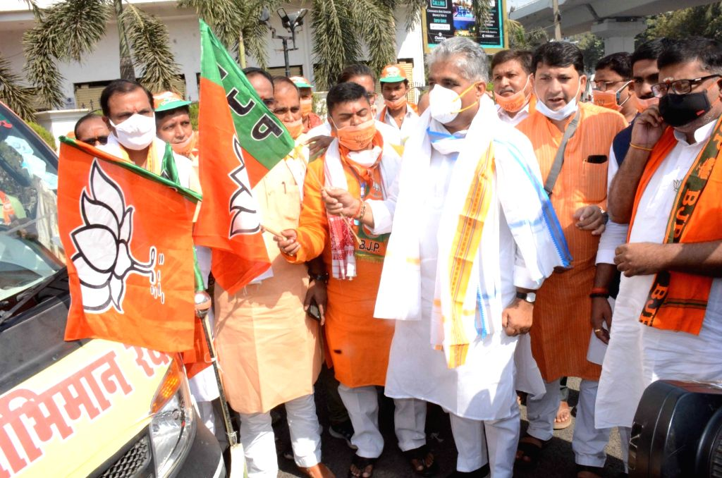 BJP National General Secretary Bhupender Yadav flags off 'Swabhiman Rath' from the party office in Patna on Oct 29, 2020.