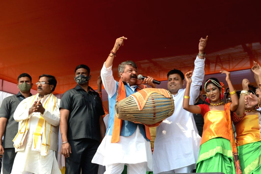 BJP National General Secretary, Kailash Vijayvargiya playing Dhol on the occasion of All India Kirtan and Baul Singer Association program at Sahid Minar Ground on Tuesday 02nd March 2021.