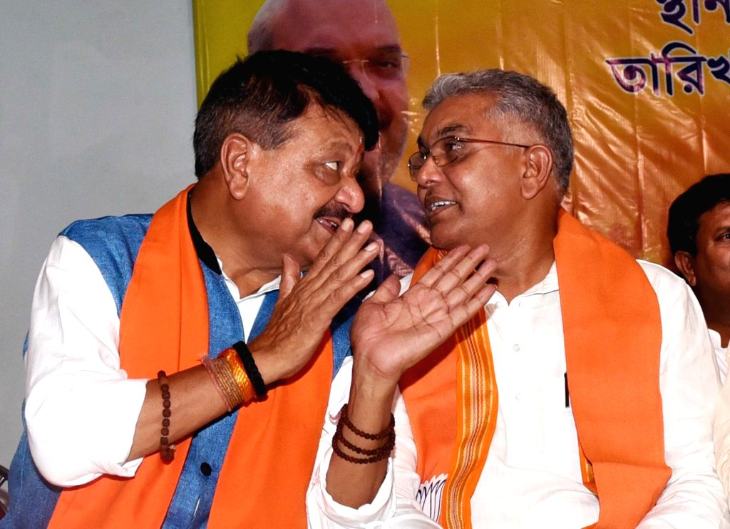 BJP National General Secretary Kailash Vijayvargiya in a conversation with West Bengal pary chief Dilip Ghosh at a party meeting in Kolkata, on June 4, 2019. - Dilip Ghosh