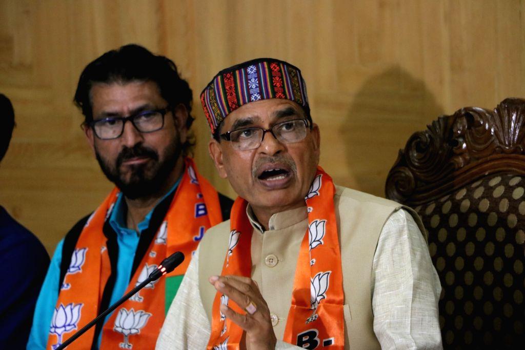 BJP National Membership Incharge Shivraj Singh Chouhan addresses a press conference, in Srinagar on July 27, 2019.