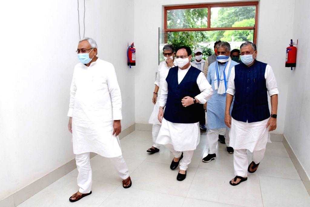 BJP National President JP Nadda accompanied by Bihar party president Sanjay Jaiswal, party National General Secretary Bhupender Yadav and state Deputy Chief Minister and BJP leader Sushil ... - Nitish Kumar and Sushil Kumar Modi