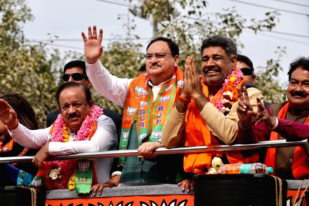 BJP National President JP Nadda accompanied by Union Minister Harsh Vardhan and the party's Adarash Nagar candidate Rajkumar Bhatia, holds a roadshow ahead of February 8 Delhi Assembly ... - Harsh Vardhan