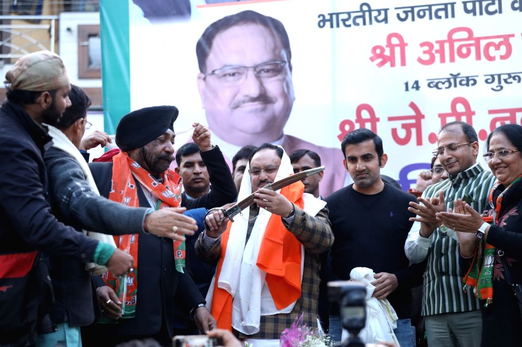 BJP National President JP Nadda and party MP Gautam Gambhir during a public meeting organised to campaign for the party's candidate Anil Goyal ahead of Delhi Assembly elections, at Krishna ...