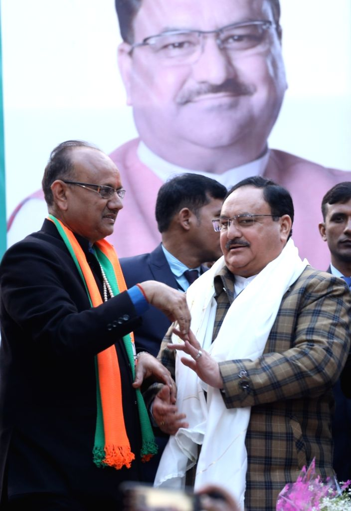 BJP National President JP Nadda with the party's candidate Anil Goyal during a public meeting ahead of Delhi Assembly elections, at Krishna Nagar in New Delhi on Jan 29, 2020.